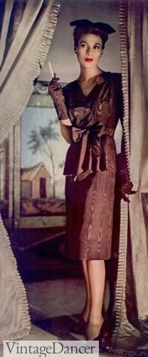 1942 bronze cocktail dress with small hat and long gloves.